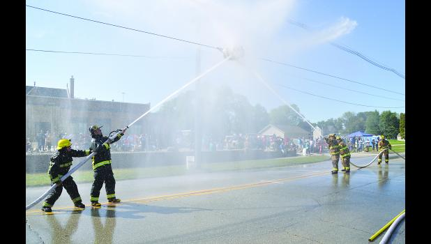 Nashua (left) battles Riverdale in the Championship match of the Drill #10, Water Application Drill, at the 140th annual Iowa Firefighters Convention held in Waverly Sept. 5-9. Riverdale went on to win.