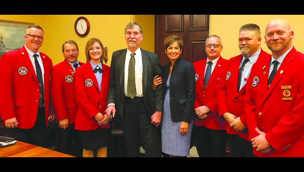 Members of the Iowa Firefighters Association (IFA) met with Iowa Governor Kim Reynolds on the day she addressed the Iowa Legislature. Pictured from left to right are: Past President Bill Halleran, President Marv Trimble, IFA Executive Director Amber Kephart, IFA Lobbyist John Pederson, Governor Kim Reynolds, IFA 2nd vice-president Gene Evans, IFA 1st vice-president Jim Shutts and IFA 3rd vice-president Nick Riley.